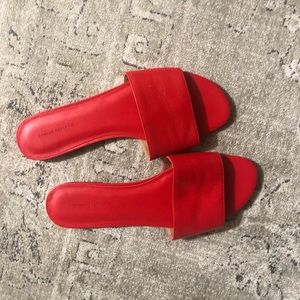 Never worn - red leather slides